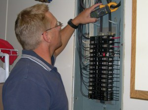 electrical panel with technician